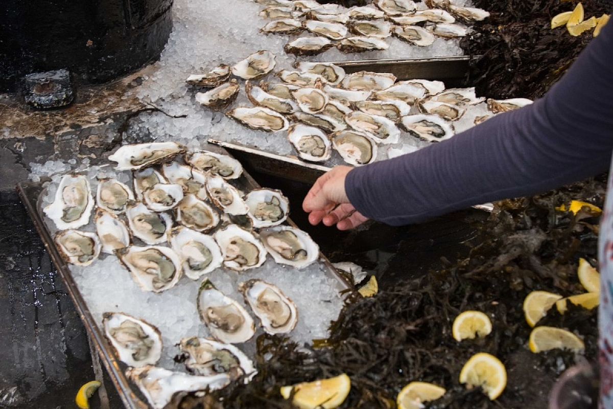 Freshly shucked oysters served from the fountain in the English Market during celebrations of 25 years of the Farmgate Cafe at the market