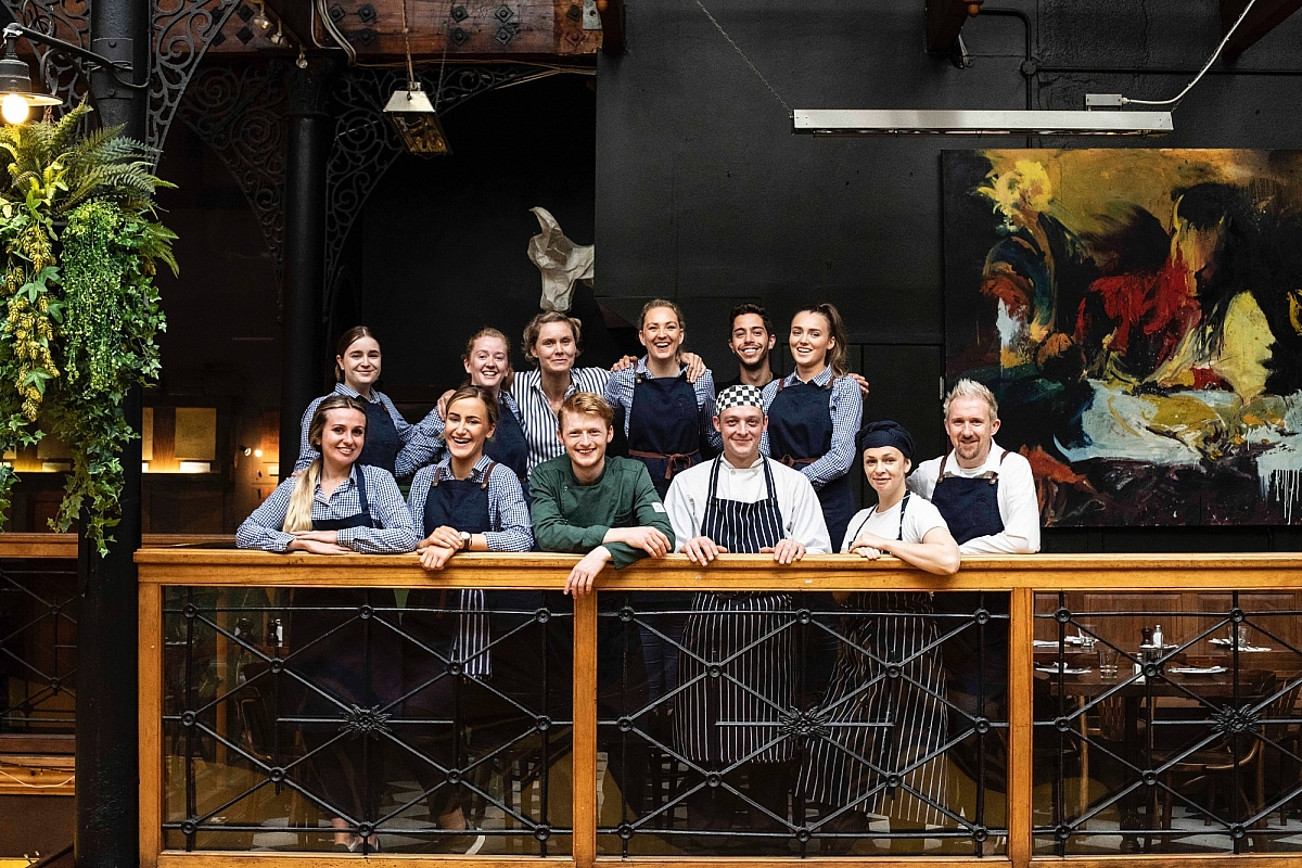 Staff photo taken on the balcony of the Farmgate Cafe in the Englishin Market Cork