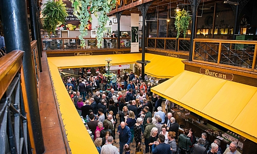 View of guests celebrating 25 years of the Farmgate Cafe at the English Market